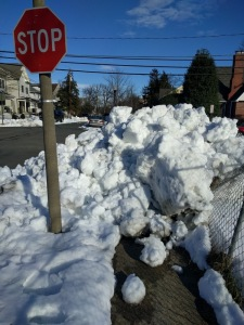 Snow bank and stop sign