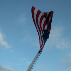 American flag over Mississippi River