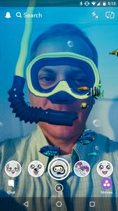 Self-portrait using Snapchat's snorkel-and-fish lens