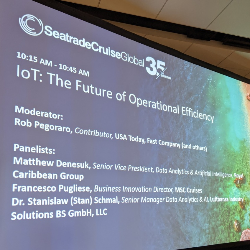 Photo of a monitor showing the participants of the first panel I moderated at the Seatrade Cruise Global convention in Miami Beach.